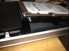 Close up on the drive showing the T6 screw that is acting as a hard drive bracket.
